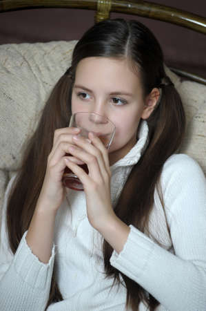 teen girl in a chair with tea Stock Photo - 12204906