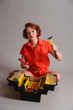 woman with a box of tools photo