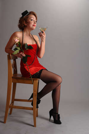 woman with a rose and a glass of Martini photo