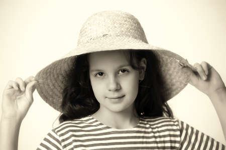 girl in a straw summer hat Stock Photo - 12205150