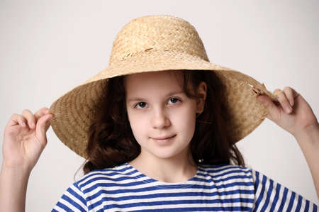 girl in a straw summer hat Stock Photo - 12205151