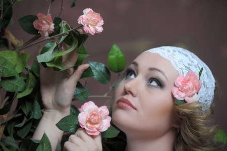 Retro portrait of Pretty woman with roses  photo