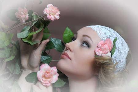 Retro portrait of Pretty woman with roses Stock Photo - 12182752