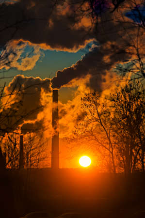 smoke from factory chimneys at sunset Stock Photo - 12187718