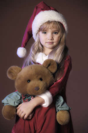 Christmas child with Teddy Bear  photo