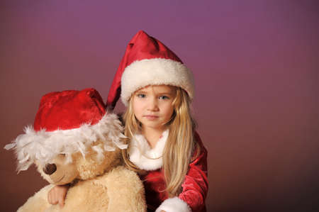 Christmas child with Teddy Bear Stock Photo - 12598619
