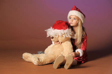 Christmas child with Teddy Bear  Stock Photo - 12598594