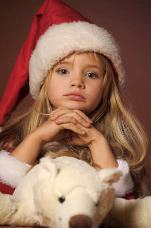 preteen girls: Christmas child with Teddy Bear