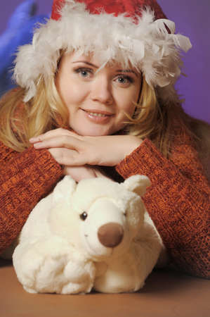 Beautiful girl in winter clothing with a polar bear toy photo
