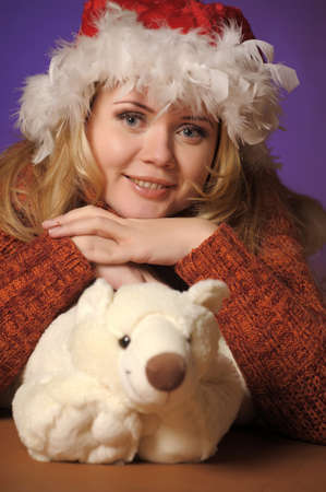 Beautiful girl in winter clothing with a polar bear toy Stock Photo - 13236073