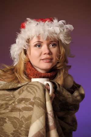 Young woman with santa hat holding a cup Stock Photo - 13236087