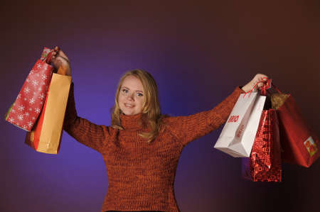 The young woman with gifts Stock Photo - 13039238