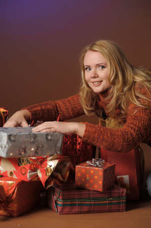 The young woman with gifts Stock Photo - 13039240