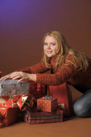 The young woman with gifts Stock Photo - 13039237