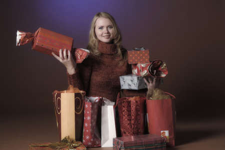 The young woman with gifts Stock Photo - 13039234