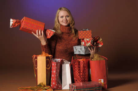 The young woman with gifts Stock Photo - 13039236
