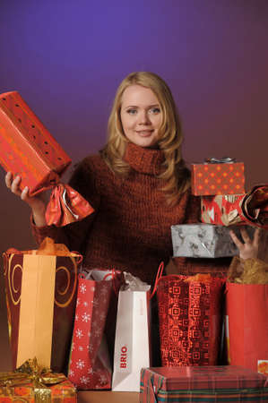 The young woman with gifts Stock Photo - 13039223
