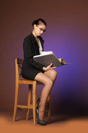 sexy business woman: Business the woman with folders of papers Stock Photo