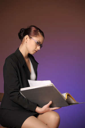 Business the woman with folders of papers Stock Photo - 12665465