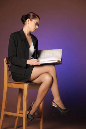 Business the woman with folders of papers Stock Photo - 12665462