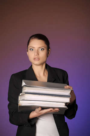 Business the woman with folders of papers Stock Photo - 12665618