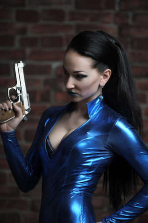 Martial young lady with gun Stock Photo - 12233496