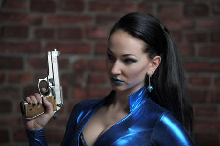latex girl: Martial young lady with gun  Stock Photo
