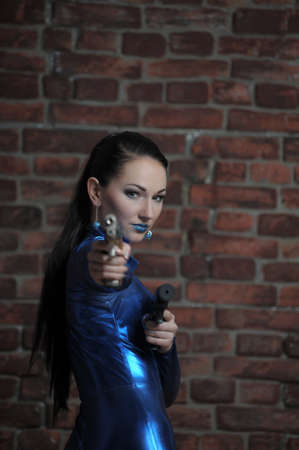 short gloves: Martial young lady with gun  Stock Photo
