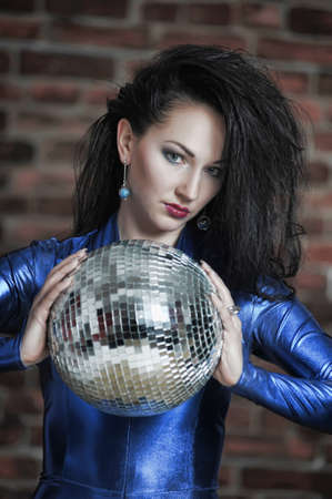Disco girl with mirror ball Stock Photo - 12233529