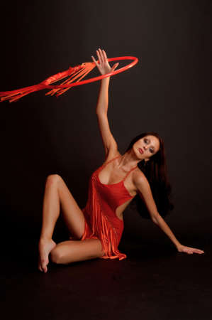 creative strength: gymnast in red Stock Photo