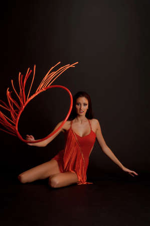 harem: gymnast in red Stock Photo