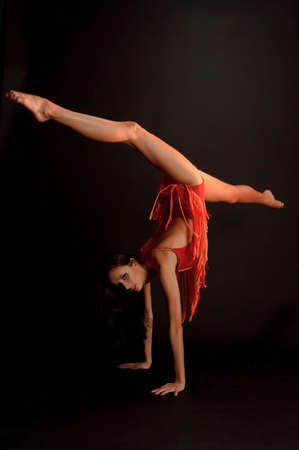 gymnast in red Stock Photo - 12202224