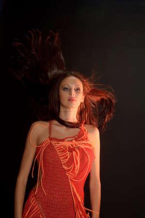 bobbed: Brunette girl in red dress
