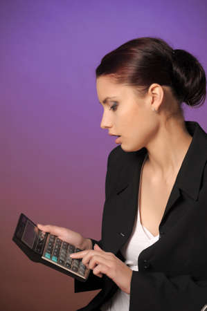 maching: The woman with the calculator Stock Photo