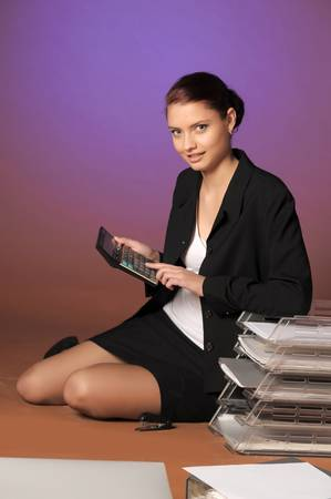 Young secretary or businesswoman in suit with notebook Stock Photo - 12374777