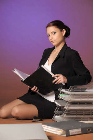 Young secretary or businesswoman in suit with notebook Stock Photo - 12374784