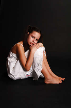 The girl the teenager in depression on a black background Stock Photo - 12205137