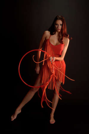 fandango: gymnast in red with a hoop