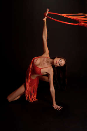 gymnast in red with a hoop Stock Photo - 12234063