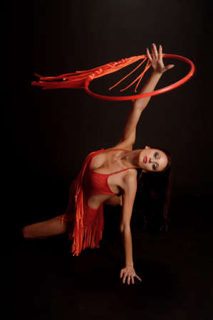 gimnasta en rojo con un aro photo