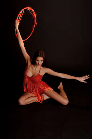 symboll: gymnast in red with a hoop