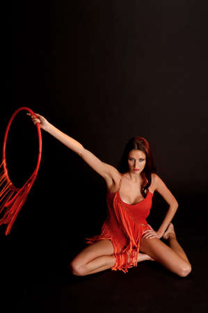 gymnast in red with a hoop Stock Photo - 12234007