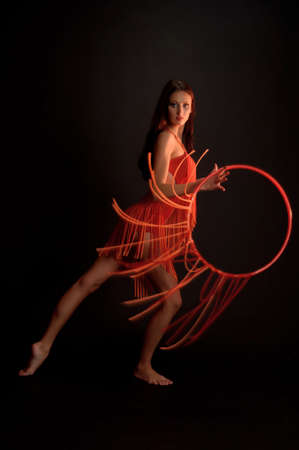 gymnast in red with a hoop photo
