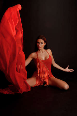 the gymnast in red with a fabric Stock Photo - 13342881
