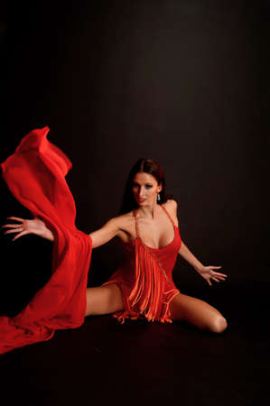 the gymnast in red with a fabric Stock Photo - 13342896