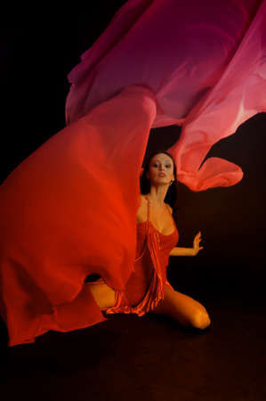 the gymnast in red with a fabric Stock Photo - 13342878