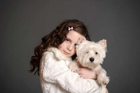 Beautiful girl with a white fluffy dog photo