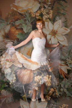 Young woman wearing wedding dress photo