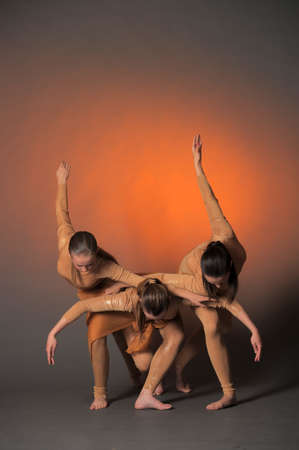 Three Dancers Performing photo