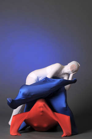 three figures in white, red and blue photo